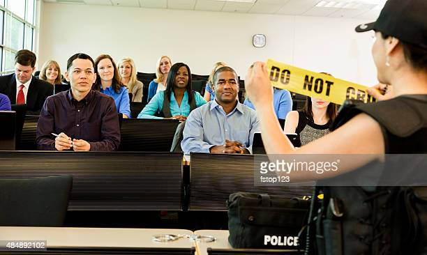 law:  policewoman speaks to police cadets in classroom. - academy stock pictures, royalty-free photos & images