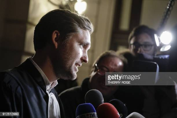Lawer Dimitri De Beco speaks to the press as he leaves the court during the first session of the 2013 Brussels Airport diamond heist case at the...