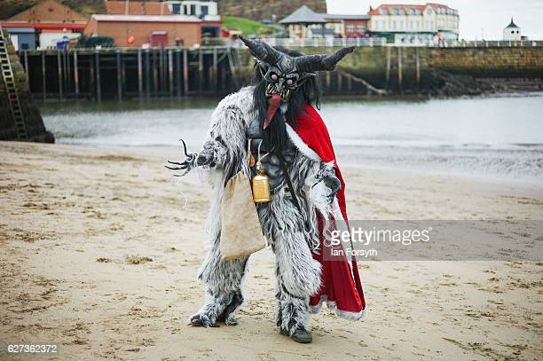 Lawerence Mitchell from Whitby dresses as the folklore figure Krampus ahead of a charity event on December 3 2016 in Whitby United Kingdom The...