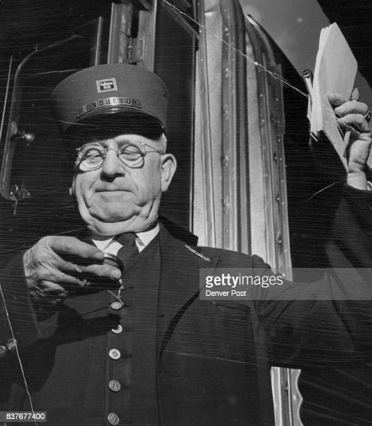 R Lawler of 1306 Elizabeth street whose initials could well stand for 'railroad' hauls out his pocket timepiece to start the Burlington Zephyr on its...