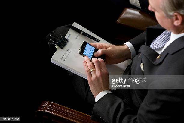 A lawmaker checks his blackberry before US President Barack Obama delivers his first State of the Union address on Capitol Hill in Washington