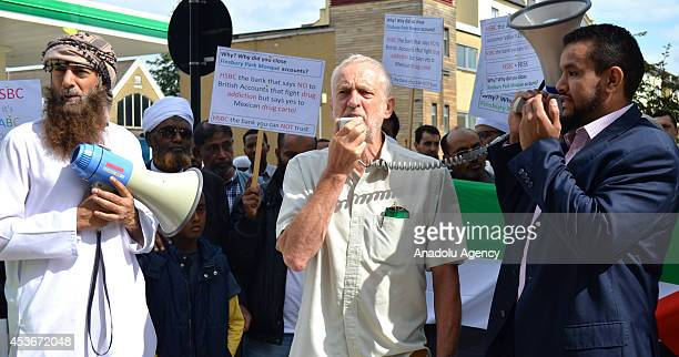 Lawmaker Jeremy Corbyn delivers a speech as Muslims living in England gather to protest against a notice by HSBC bank to close the mosques bank...
