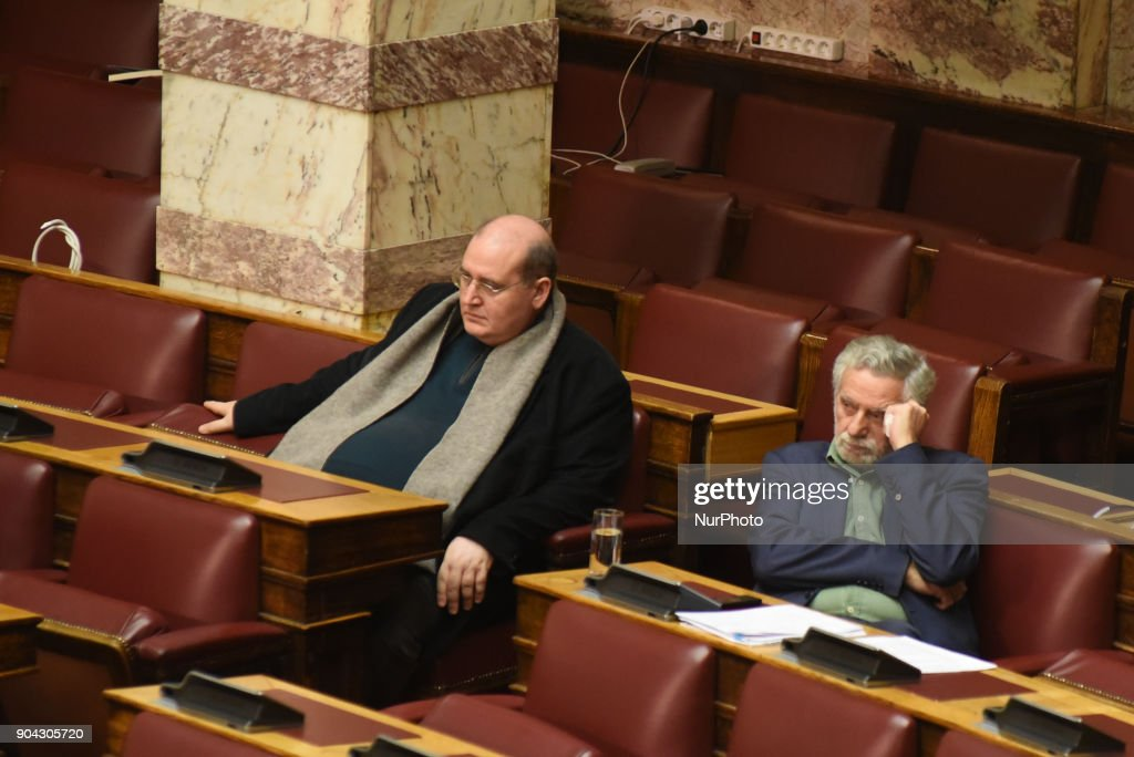SYRIZA lawmaker, Nikos Filis (L) and Nikos Dritsas at the Hellenic Parliament in Athens on January 12, 2018 during a discussion about an urgent draft law for the prerequisites of the third inspection of the third credit package for Greece.