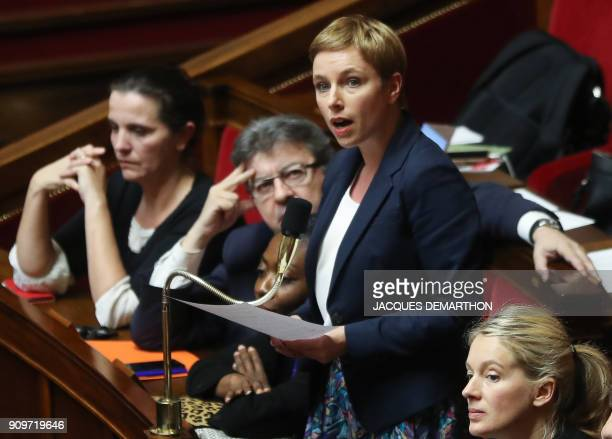 Lawmaker of the France Insoumise party Clementine Autain speaks as party leader JeanLuc Melenchon looks on during a session of questions to the...