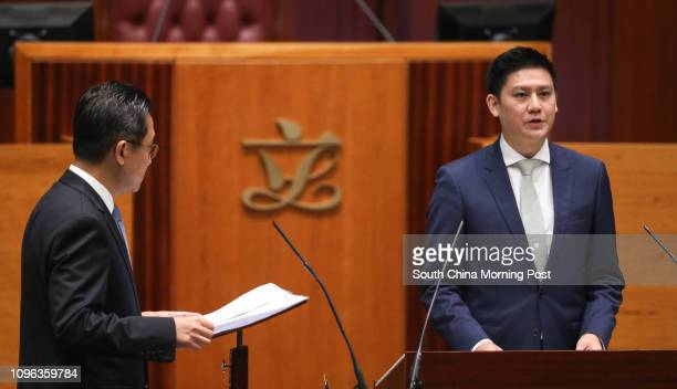 Lawmakerelect Jeremy Tam Manho of Civic Party at the 6th Legco council oath taking session while Legco Secretary General Kenneth Chan Weion looks on...