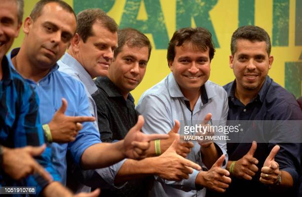 Lawmakers and members of the Social Liberal Party imitate their presidential candidate Jair Bolsonaro wellknown gungesture after a press conference...