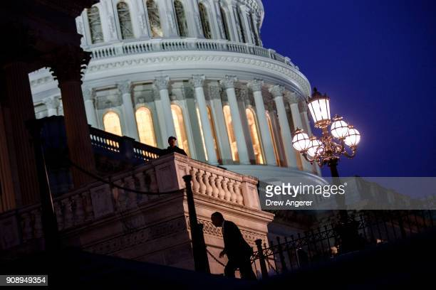 Lawmakers arrive to the House chamber to vote on the continuing resolution to fund the federal government Capitol Hill January 22 2018 in Washington...