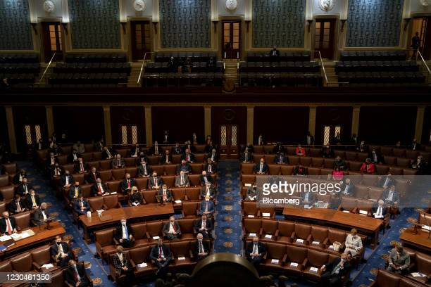 Lawmakers attend a joint session of Congress to count the Electoral College votes of the 2020 presidential election in the House Chamber in...