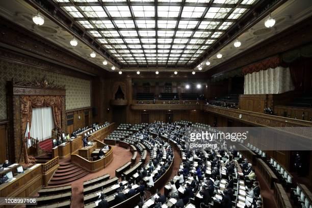 Lawmakers attend a plenary session at the upper house of parliament in Tokyo, Japan, on Friday, April 3, 2020. Japan's Prime Minister Shinzo Abehas...