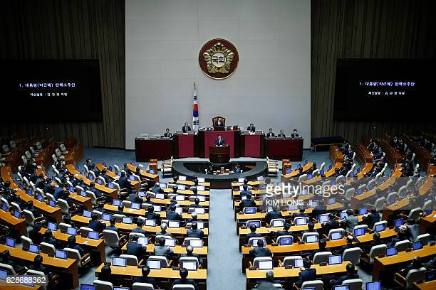 Lawmakers attend a plenary session to vote on the impeachment bill of President Park Geunhye at the National Assembly in Seoul South Korea December 9...