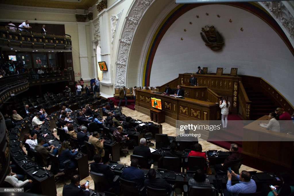 Lawmakers attend a special session of the National Assembly of Caracas, Venezuela, on Saturday, Aug. 19, 2017. Venezuela's new legislative super body took over the functions of the country's only remaining opposition-run institution -- the National Assembly -- by approving a decree that empowers it to pass laws on a range of issues. Photographer: Wil Riera/Bloomberg via Getty Images