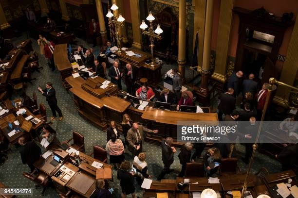 Lawmakers exit the floor as Flint residents and allies from regions nearby disrupt the state legislature with a chant in protest of the closing water...