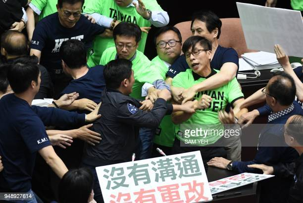 Lawmakers from the ruling Democratic Progressive Party and the Kuomintang scuffle during a protest at the Parliament in Taipei on April 20, 2018. -...