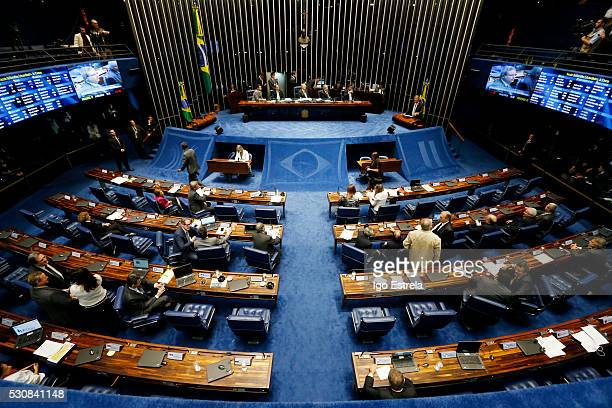 Lawmakers gather during a special session in the Brazilian Senate to vote on whether to accept impeachment charges against embattled Brazilian...