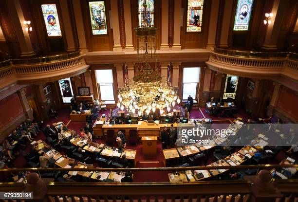 Lawmakers gather on the Senate floor at Colorado State Capitol on May 5 2017 in Denver Colorado The 2017 legislative session is nearing its end