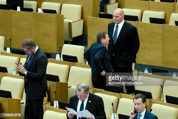 Lawmakers including former wrestler Alexander Karelin attend the second reading of the constitutional reform bill during a session of the State Duma...