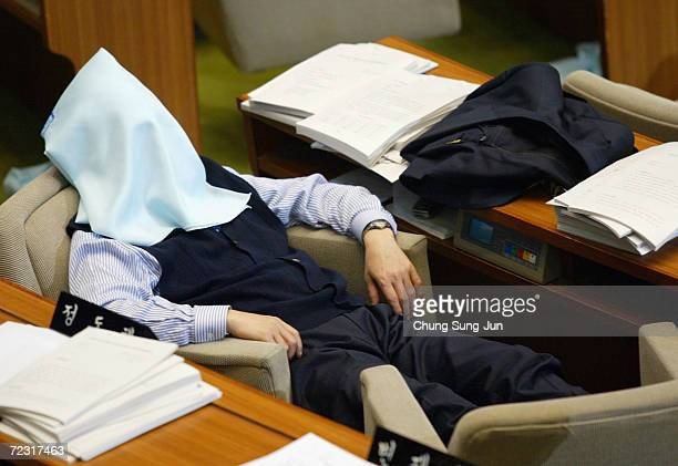 Lawmakers of the main opposition Grand National Party sleep at the National Assembly on December 31 2004 in Seoul South Korea They have continued to...
