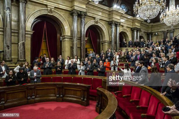 Lawmakers prepare to leave following the conclusion of the first session of the Catalan parliament in Barcelona Spain on Wednesday Jan 17 2018...