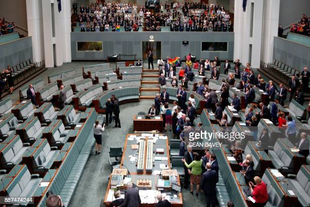 Lawmakers react after the SameSex Marriage Act was passed in the Federal Parliament in Canberra on December 7 2017 Gay couples will be able to...