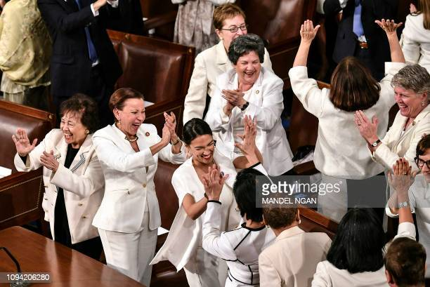 TOPSHOT Lawmakers react to US President Donald Trump's acknowledgement of an increased presence of women in the workforce and on Capitol Hill during...
