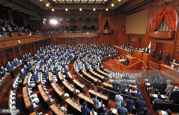 Lawmakers stand up as they vote for legalising casiono at a lower house plenary session at the diet building on December 6 2016 in Tokyo Japan