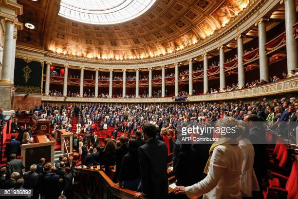 Lawmakers stand up at the start of the speech by French Les Republicains party lawmaker Bernard Brochand the most senior member of the French...