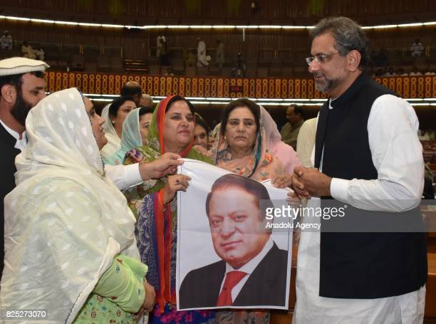 ISLAMABAD PAKISTAN AUGUST 01 Lawmakers talk with Shahid Khaqan Abbasi newly elected interim Prime Minister at the National Assembly in Islamabad...