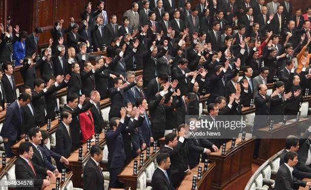 Lawmakers throw their arms in the air in a customary banzai when the House of Representatives was dissolved on Sept 28 for a general election set to...
