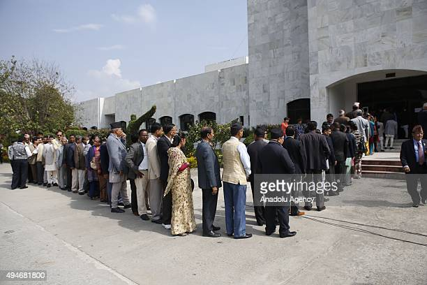 Lawmakers wait in line to cast their votes during Nepal's presidential election at the parliament in Kathmandu Nepal 28 October 2015 Bhandari who is...