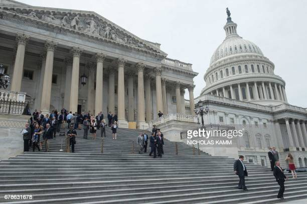 Lawmakers walk out of the US Capitol in Washington DC on May 4 2017 after the House of Representatives narrowly passed a Republican effort to repeal...