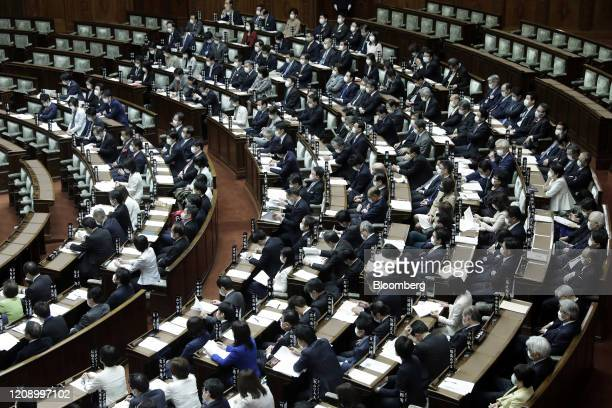 Lawmakers wearing protective masks attend a plenary session at the upper house of parliament in Tokyo, Japan, on Friday, April 3, 2020. Japan's Prime...