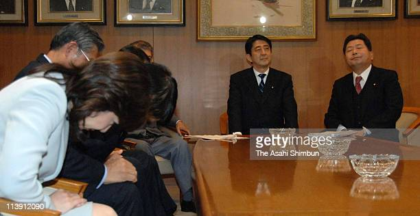 Lawmakers who opposed to Japan Post privatization Bill in 2005 including Seiko Noda bow to Japanese Prime Minister Shinzo Abe and Liberal Democratic...