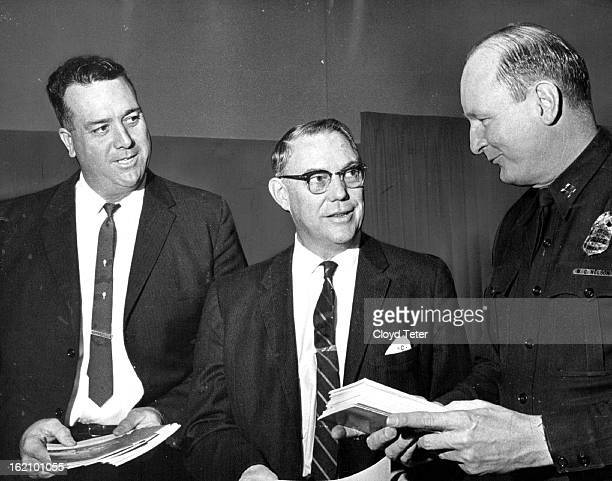 JAN 24 1964 JAN 25 1964 Lawmen Discuss Road Safety Highway safety Literature is examined by left to right Jack Fowler superintendent of safety at La...