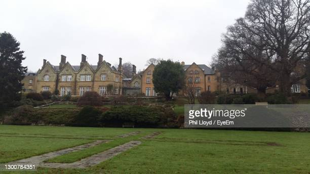 lawn by building against sky - the past stock pictures, royalty-free photos & images
