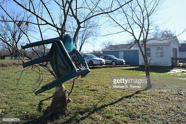 Lawn chairs are seen tangled in a tree after floodwaters recede on January 1 2016 in Pacific Missouri Pacific is one of many Missouri towns looking...