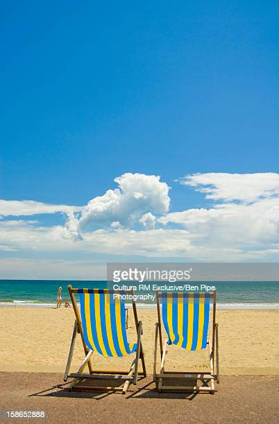 Lawn chairs on sandy beach
