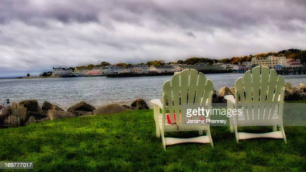 Lawn chairs over look the Harbor on Mackinaw Island on a overcast fall day.