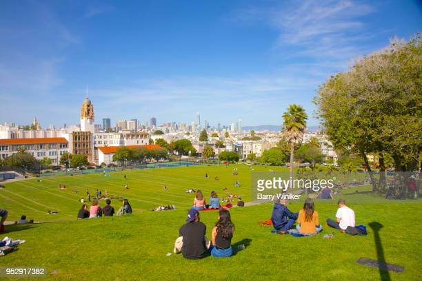 Lawn filled with people enjoying a sunny day in San Francisco's Mission Dolores Park