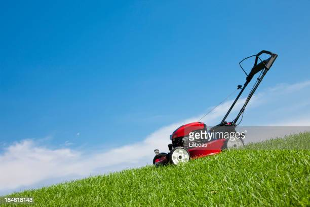 lawn mower in the grass - lawn mower stock pictures, royalty-free photos & images