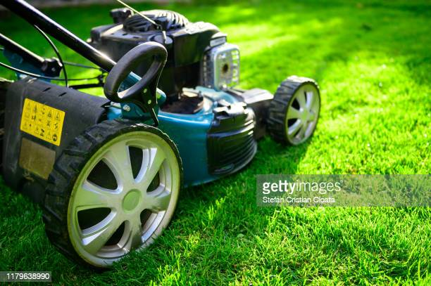 lawn mower on green grass in a sunny day. - lawn stock pictures, royalty-free photos & images