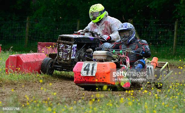 Lawn mowers receive mechanical attention as competitors take part in the British Lawn Mower Racing - Double 4 Hour race for Class 2, 3 and 4 mower...