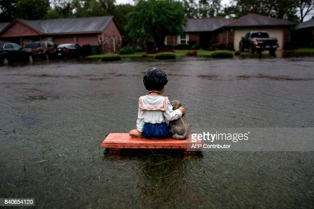 Lawn ornament is seen on a flooded street during the aftermath of Hurricane Harvey August 29, 2017 in Houston, Texas. Harvey has set what forecasters...