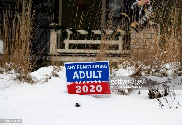A lawn sign that reads Any Functioning Adult 2020 is staked outside of a home in Des Moines Iowa on January 25 2020 With nine days to go candidates...