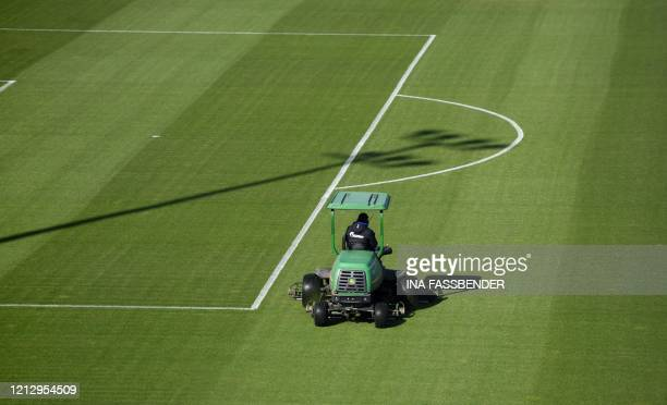 A lawnmower drives on the pitch at the training grounds of German first division Bundesliga football club FC Schalke 04 in Gelsenkirchen western...