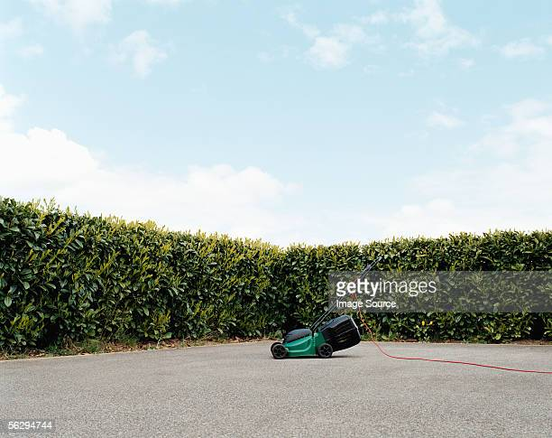 Lawnmower in a concrete garden