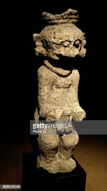 Lawolo' a masculine protective statue used to scare an enemy from Nias Indonesia 19th century calcified stone