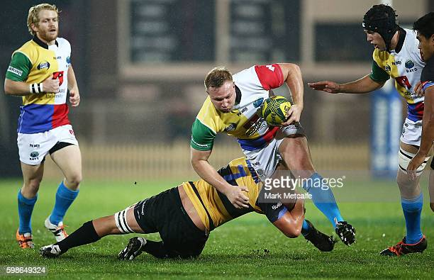 Lawrance Hunting of the Rays is tackled by Richard Hardwick of the Spirit during the round two NRC match between the Sydney Rays and the Perth Spirit...