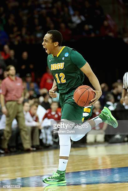 Lawrence Alexander of the North Dakota State Bison celebrates against the Oklahoma Sooners during the second round of the 2014 NCAA Men's Basketball...