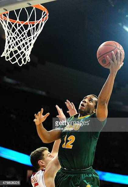 Lawrence Alexander of the North Dakota State Bison reaches for the ball over Tyler Neal of the Oklahoma Sooners during the second round of the 2014...