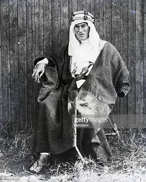 Lawrence, as Lawrence Of Arabia. Full length, seated postion wearing his Arab costume and dagger.